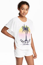 Top à base arrondie - Blanc/palmiers - ENFANT | H&M FR 1