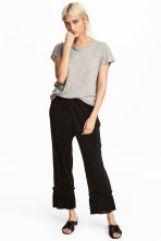 Pleated trousers - Black - Ladies | H&M 1