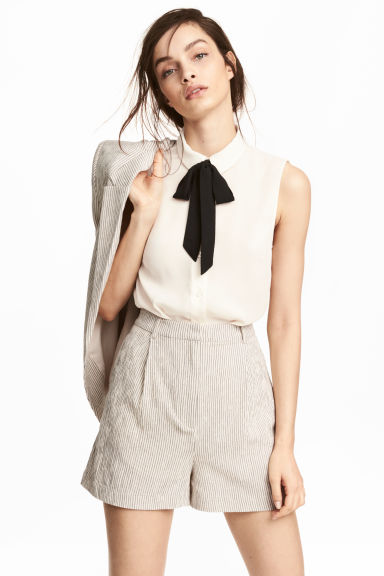 Sleeveless blouse - Natural white - Ladies | H&M 1