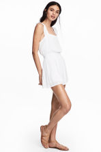 Crinkled playsuit - White - Ladies | H&M 1