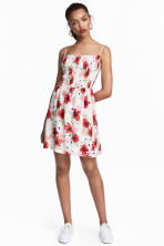 Smocked dress - White/Floral - Ladies | H&M CN 1