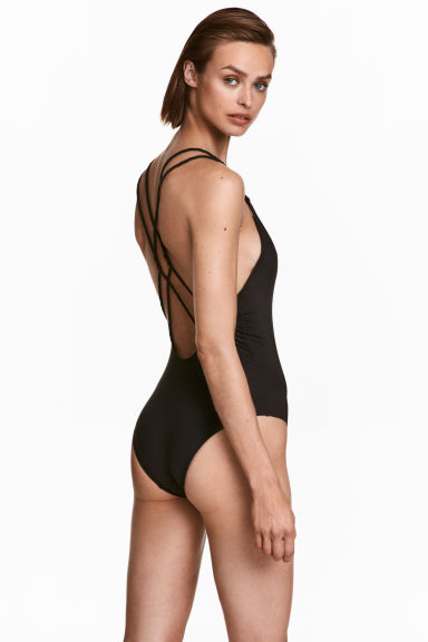 Swimsuit with twisted straps