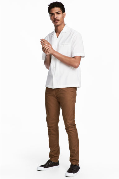 Cotton chinos Skinny fit - Dark camel - Men | H&M 1