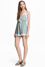 Playsuit with lace - Dusky green -  | H&M IE 1