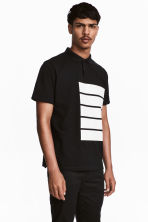 Polo shirt with a print motif - Black - Men | H&M 1