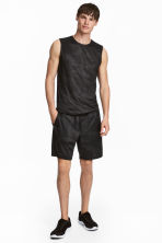 Knee-length sports shorts - Black/Patterned - Men | H&M 1