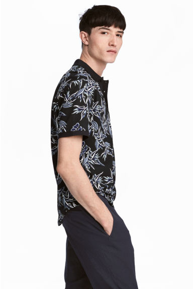 Printed piqué polo shirt - Black/Patterned - Men | H&M CN
