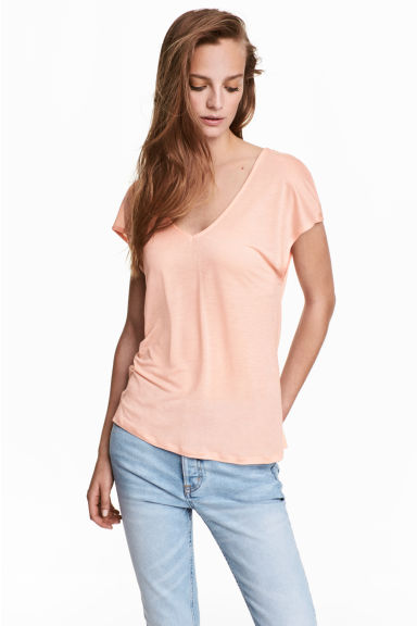 Lyocell V-neck top - Light apricot - Ladies | H&M 1