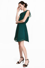 Dress with frilled sleeves - Dark green/Spotted - Ladies | H&M CN 1