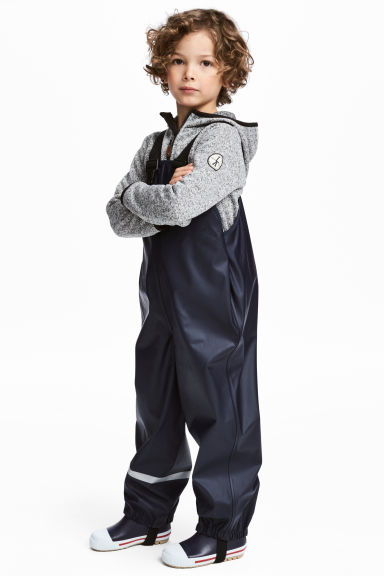 Rain trousers with braces - Dark blue - Kids | H&M 1