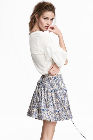 Pleated skirt - Light beige/Floral - Ladies | H&M CN 1