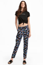 Pull-on trousers - Black/Leaf - Ladies | H&M CA 1