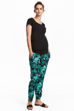 MAMA Patterned trousers - Black/Leaf - Ladies | H&M 1