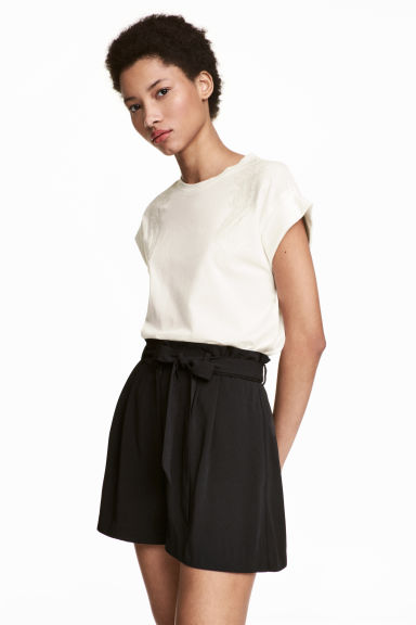 Top con ricami - Bianco naturale - DONNA | H&M IT