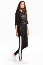 Jersey leggings with stripes - Black - Ladies | H&M 1