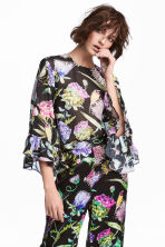 Trumpet-sleeved blouse - Black/Floral - Ladies | H&M 1