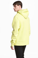 Oversized hooded top - Light yellow - Men | H&M 1