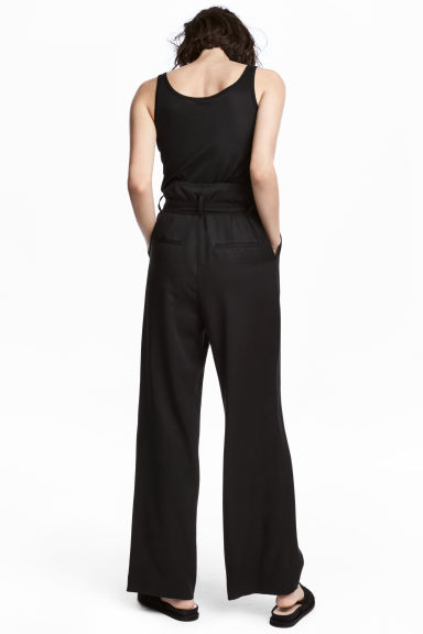 Wide lyocell trousers - Black - Ladies | H&M CA