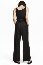 Wide lyocell trousers - Black - Ladies | H&M 1
