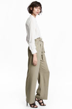 Wide lyocell trousers - Khaki - Ladies | H&M CA 1