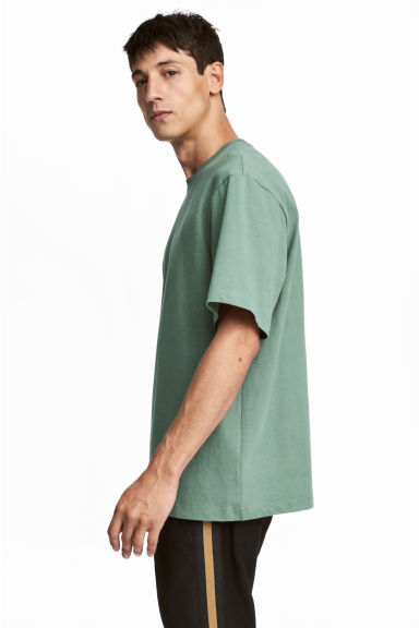 Round-neck T-shirt Loose fit - Green - Men | H&M CN 1