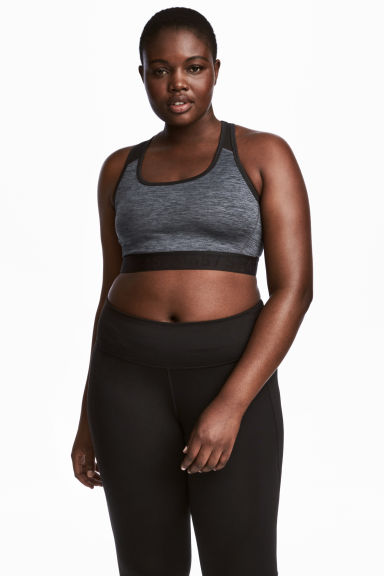 H&M+ Sports bra Medium support - Dark grey marl - Ladies | H&M IE