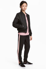 Pantaloni pull-on con bande - Nero/rosa -  | H&M IT 1