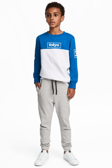 Low-crotch joggers - Light grey marl - Kids | H&M 1