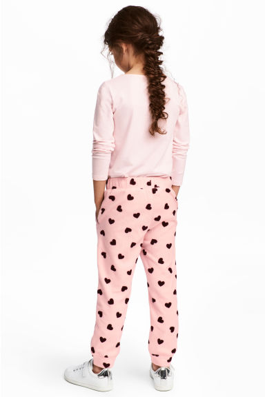 Fleece trousers - Light pink/Hearts - Kids | H&M CN 1