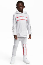 Sweatpants with a print - Light grey/RUN DMC - Kids | H&M 1