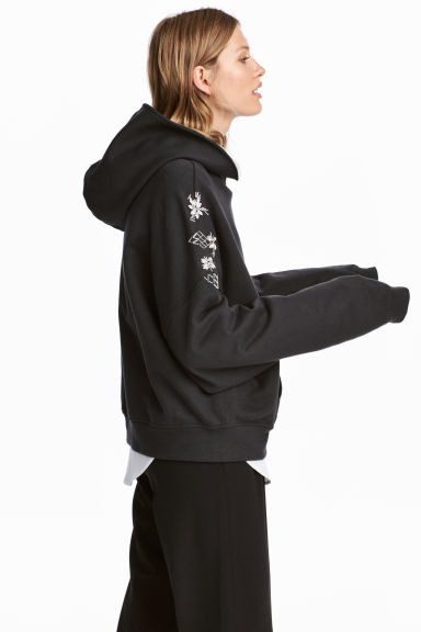 Oversized hooded top - Black - Ladies | H&M 1