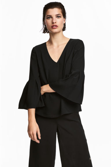 Trumpet-sleeved blouse - Black - Ladies | H&M IE