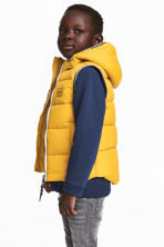 Padded gilet with a hood - Yellow - Kids | H&M 1
