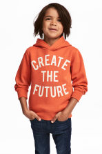 Hooded top with a print motif - Orange -  | H&M 1