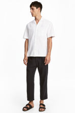 Wide linen-blend trousers - Black - Men | H&M GB 1