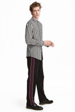 Wide side-striped trousers - Black - Men | H&M CN 1