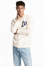 Sweatshirt with raglan sleeves - Natural white - Men | H&M 1