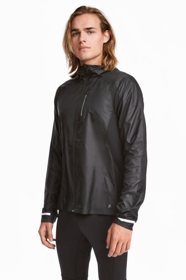 Running jacket with a hood Model