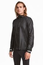 Running jacket with a hood - Black - Men | H&M 1