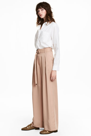 Wide lyocell trousers - Light beige - Ladies | H&M IE