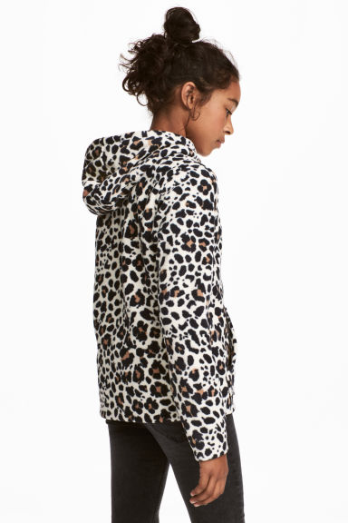 Fleece jacket with a hood - Natural white/Leopard print - Kids | H&M GB 1