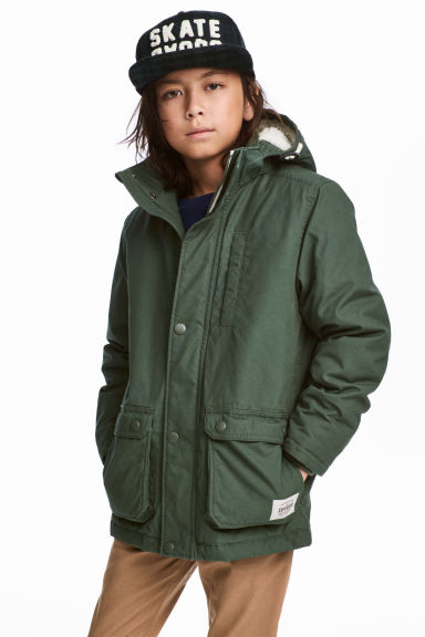 Padded parka with a hood - Dark green - Kids | H&M CN