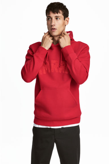 Hooded top with a motif - Bright red - Men | H&M CN 1