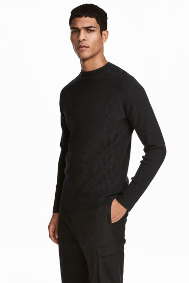 Rib-knit merino-blend jumper Model