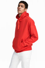 Oversized hooded top - Bright red - Men | H&M 1