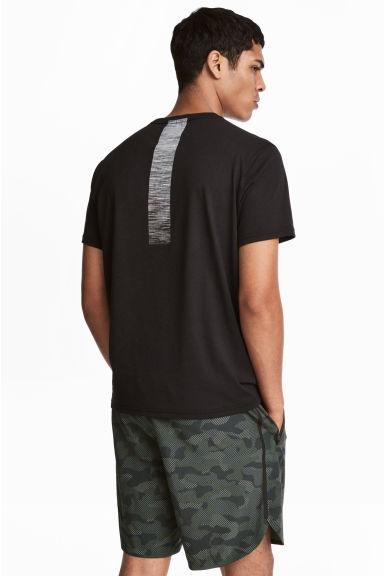 Printed sports top - Black - Men | H&M CN 1