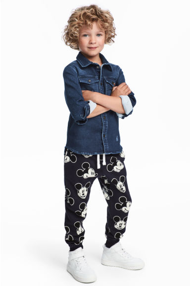 Patterned joggers - Dark blue/Mickey Mouse -  | H&M 1