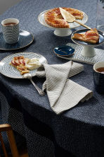 Patterned cotton tablecloth - Dark blue/White patterned - Home All | H&M CN 1