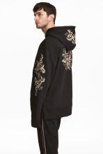 Hooded top with embroidery - Black/Gold-coloured - Men | H&M 1