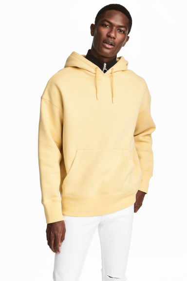 Wide hooded top - Light yellow - Men | H&M GB